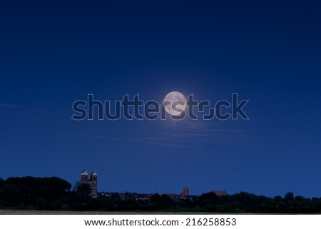 Full moon over Prenzlau - Prenzlau is a city in the Uckermark District of Brandenburg in Germany - stock photo