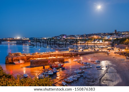 Full moon over the harbour and town at Newquay Cornwall England UK - stock photo