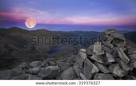 full moon over the mountains - stock photo