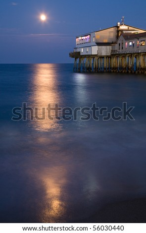 Full moon over the Old Orchard Beach Pier - stock photo