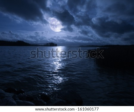 full moon over water collage - stock photo