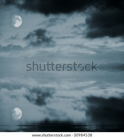 Full moon reflecting in rippled water - stock photo
