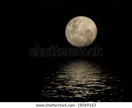 full moon with reflection in water surface - stock photo