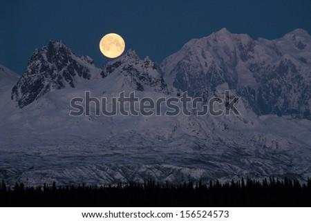 Full Moonrise over Mount McKinley Denali Mountain Range Alaska Midnight - stock photo