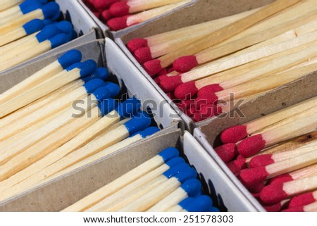 full of matchboxes with matches inside the blue and red - stock photo