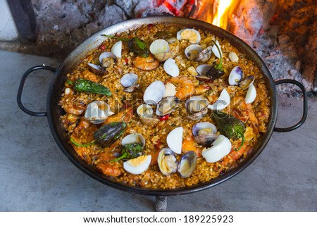 Full Paella cooked on a wood fire at home - stock photo