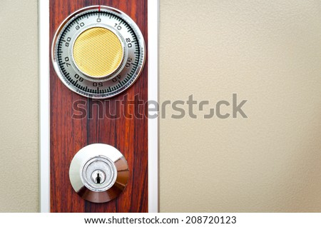 Full picture of safe door with password ring and key insert hole on wood pattern decoration - stock photo