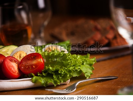 Full plate of fresh salad with tomato, cucumbers, eggs and lettu - stock photo