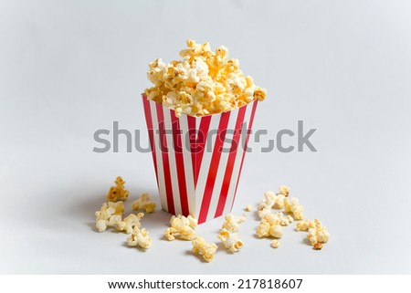 Full popcorn in classic popcorn box - stock photo
