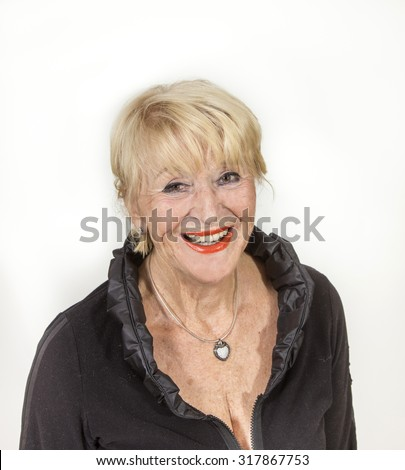 full portrait of attractive senior woman in elegant dress - stock photo