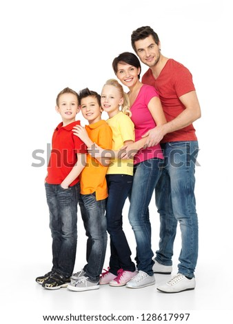 Full portrait of happy young family with three children standing together in line - isolated on white background - stock photo