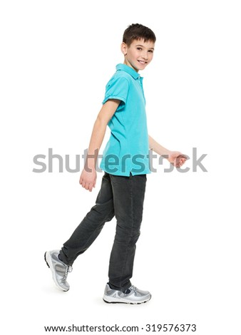 Full portrait of smiling  walking teen boy in blue t-shirt casuals  isolated on white background. 
