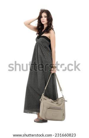 Full Portrait of stylish woman holding bag walking   - stock photo