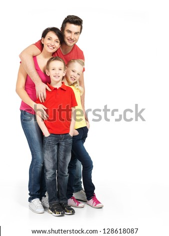 Full portrait of the happy young family with two children isolated on white background - stock photo