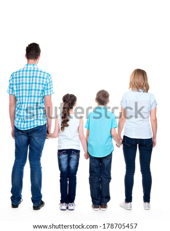 Full rear portrait of the  family with children -  isolated on white background - stock photo