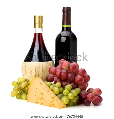 Full red wine bottles and grapes isolated on white background - stock photo