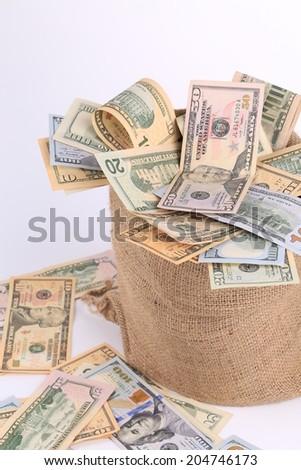Full sack with dollar bills. Whole background. - stock photo