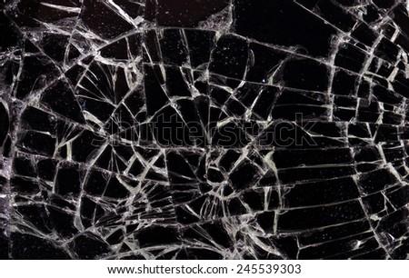 Full screen broken glass, black background horizontal - stock photo
