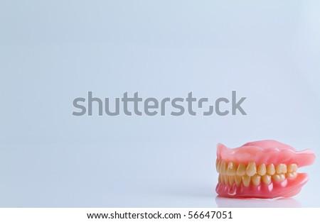 full set of acrylic denture isolated on white background - stock photo