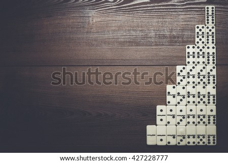 full set of domino pieces over wooden table - stock photo