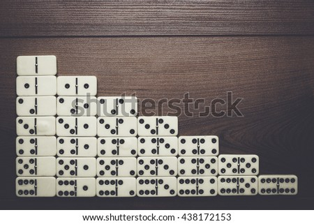 full set of domino pieces over wooden table background - stock photo