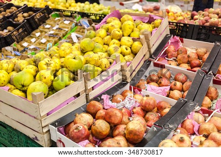 Full shells with fruits in supermarket. World consumption problem. - stock photo