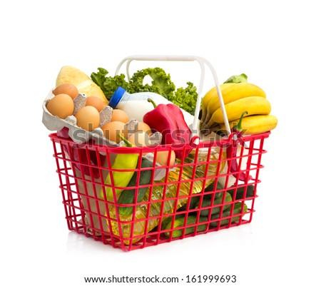 Full shopping basket, isolated over white background  - stock photo