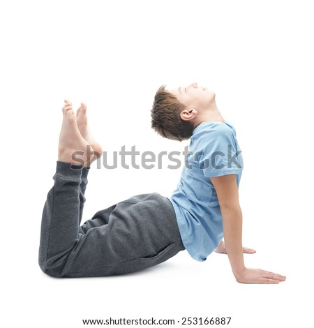 Full shot of a caucasian 12 years old children boy in a blue t-shirt doing yoga or stretches. Composition isolated over the white background - stock photo