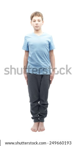 Full shot portrait of a caucasian 12 years old childen boy in a blue t-shirt - stock photo