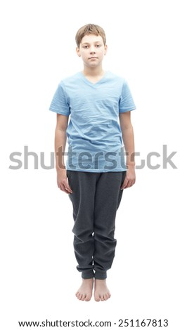 Full shot portrait of a relaxed caucasian 12 years old children boy in a blue t-shirt - stock photo
