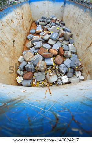full tank of gas counters broken and rusted in a municipal landfill - stock photo