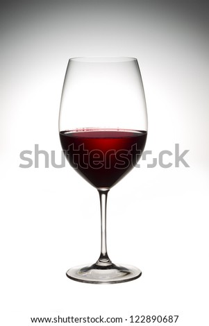 Full view image of red wine in a glass isolated on a  background - stock photo