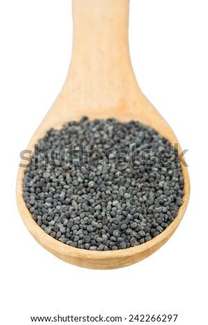 Full wooden spoon poppy grains - stock photo