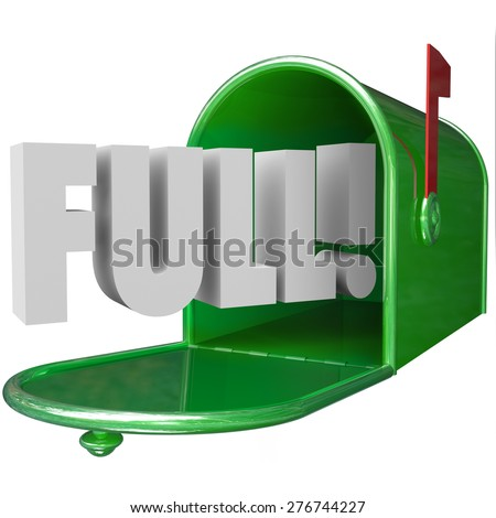 Full Word in 3d letters in a green metal mailbox to illustrate junk messages overflowing an email inbox - stock photo