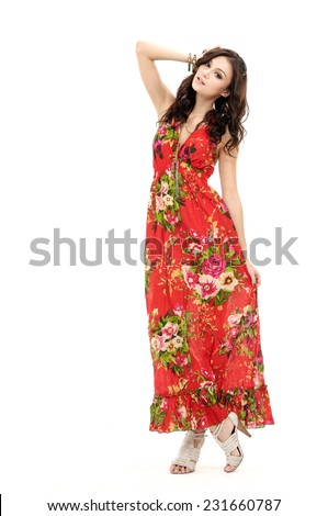 Full young stylish slim woman in sundress posing in studio  - stock photo