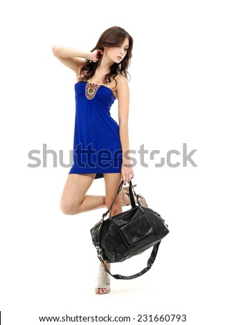 Full young stylish slim woman with handbag posing  - stock photo