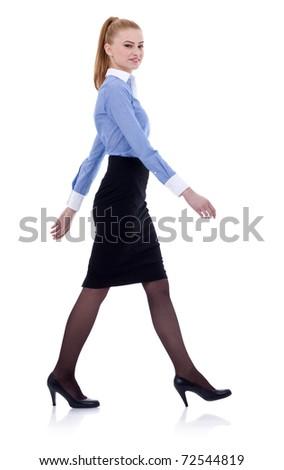 Fullbody business woman walking, isolated on white - stock photo