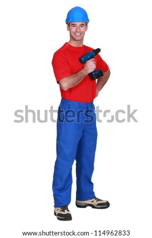 fullbody portrait of craftsman holding cordless drill - stock photo