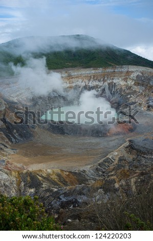 Fumes coming out of the hot Poas volcano lagoon, Costa Rica, Central America - stock photo