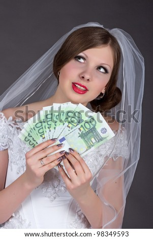 Fun Bride with money - stock photo
