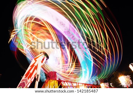 Fun Fair, long exposure. Light trails motion. - stock photo