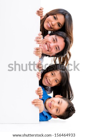 Fun family with a banner ad - isolated over a white background  - stock photo