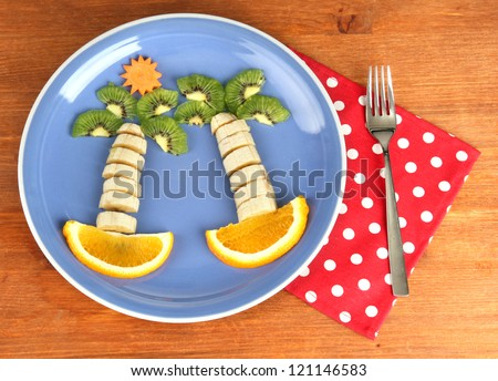 fun food for kids on wooden background - stock photo