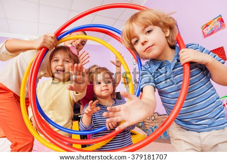 Fun in active class lesson boy and girls with hoop - stock photo