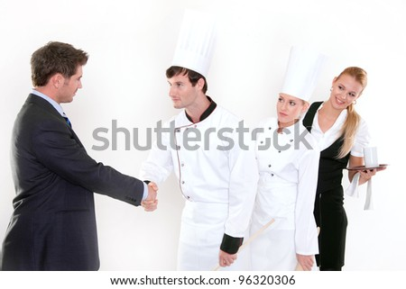Fun in the kitchen - two cheering chefs - stock photo