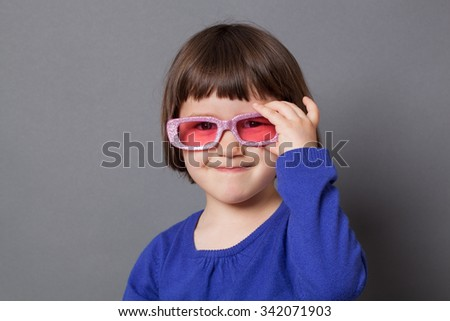 fun kid glasses concept - happy preschool child proud of wearing sparkling pink glasses for comic disco outfit or positive future,studio shot - stock photo