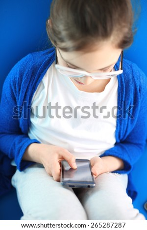 Fun mobile phone. Teenager with mobile phone dials the number and write your message.  - stock photo