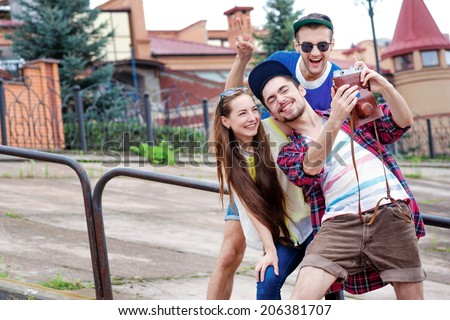 Fun together. Friends have fun together outdoors. Young people hugging - stock photo