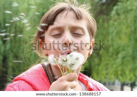 Fun with dandelions - stock photo