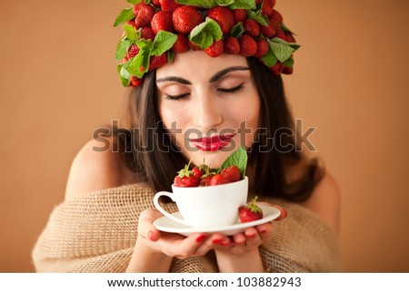 Fun woman with strawberry hat  and cup of strawberry tea,enjoying - stock photo